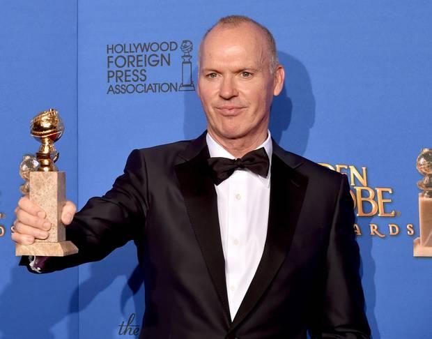 Michael Keaton with his Golden Globe for Birdman